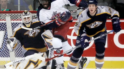 """<p>               FILE - In this Jan. 12, 2007, file photo, Nashville Predators center Jerred Smithson (25) clears the puck away from Columbus Blue Jackets right wing Anson Carter, center, in the first period of an NHL hockey game in Nashville, Tenn. Carter played a decade in the NHL and has since become an analyst for NBC Sports, which will launch """"Hockey Culture"""" with him at the center of the show. (AP Photo/Mark Humphrey, File)             </p>"""