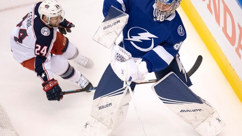 <p>               Tampa Bay Lightning goaltender Andrei Vasilevskiy (88) clears the puck under pressure from Columbus Blue Jackets center Nathan Gerbe (24) during the first period in Game 1 of an NHL hockey Stanley Cup first-round playoff series, Tuesday, Aug. 11, 2020, in Toronto. (Frank Gunn/The Canadian Press via AP)             </p>