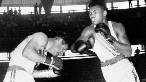 <p>               FILE - In this Sept. 3, 1960, file photo, Cassius Clay, 18-year-old from Louisville, Ky., throws a right at Tony Madigan of Australia, left, during the light heavyweight boxing semi-finals at the Summer Olympic Games in Rome. The 1960 Rome Summer Olympics set the standard for every Olympiad to follow. These Games were the first televised in the United States (AP Photo/File)             </p>