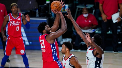 <p>               Philadelphia 76ers center Joel Embiid (21) shoots over Washington Wizards center Thomas Bryant (13) during the second half of an NBA basketball game Wednesday, Aug. 5, 2020 in Lake Buena Vista, Fla. (AP Photo/Ashley Landis)             </p>