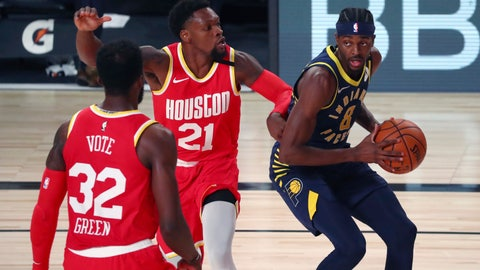 <p>               Indiana Pacers forward Justin Holiday (8) drives to the basket against Houston Rockets guard Michael Frazier (21) and forward Jeff Green (32) during the second half of an NBA basketball game Wednesday, Aug. 12, 2020, in Lake Buena Vista, Fla. (Kim Klement/Pool Photo via AP)             </p>