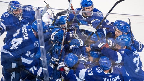 <p>               The Tampa Bay Lightning celebrate after Brayden Point (21) scored against the Columbus Blue Jackets during the fifth overtime in Game 1 of an NHL hockey Stanley Cup first-round playoff series, Tuesday, Aug. 11, 2020, in Toronto. (Frank Gunn/The Canadian Press via AP)             </p>
