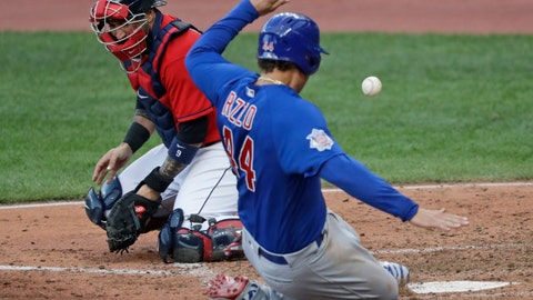 <p>               Chicago Cubs' Anthony Rizzo, right, scores as Cleveland Indians catcher Sandy Leon can't hold onto the ball in the fifth inning in a baseball game, Wednesday, Aug. 12, 2020, in Cleveland. (AP Photo/Tony Dejak)             </p>