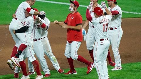 <p>               Cincinnati Reds teammates celebrate after defeating the Kansas City Royals in a baseball game at Great American Ballpark in Cincinnati, Tuesday, Aug. 11, 2020. (AP Photo/Bryan Woolston)             </p>