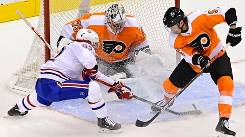 <p>               Philadelphia Flyers goaltender Carter Hart (79) makes a save on Montreal Canadiens' Artturi Lehkonen (62) as Flyers' Philippe Myers (5) defends during the second period of an NHL Eastern Conference Stanley Cup hockey playoff game in Toronto, Wednesday, Aug. 12, 2020. (Frank Gunn/The Canadian Press via AP)             </p>