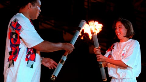 <p>               FILE - In this July 19, 1996, file photo, American swimmer Janet Evans passes the Olympic flame to Muhammad Ali during the 1996 Summer Olympic Games Opening Ceremony in Atlanta. (AP Photo/Michael Probst, File)             </p>