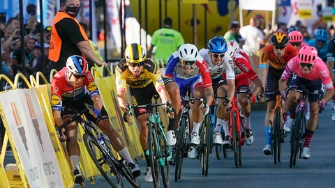 <p>               Sprinting for the win Dutch cyclist Fabio Jakobsen, left, hits side barriers at the start of a crash with his countryman Dylan Groenewegen, 2nd left, on the final stretch of the opening stage of the Tour de Pologne race in Katowice, Poland, on Wednesday, Aug. 5, 2020. Injured Jakobsen was taken to hospital in serious condition and put into an induced coma. Jakobsen was declared the winner of the opening stage and Groenewegen was disqualified. (AP Photo/Tomasz Markowski)             </p>