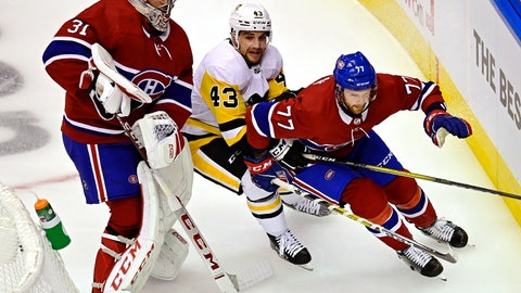<p>               Montreal Canadiens goaltender Carey Price (31) stays out of the way as Pittsburgh Penguins' Conor Sheary (43) chases Canadiens' Brett Kulak (77) during first period NHL Eastern Conference Stanley Cup playoff action in Toronto on Wednesday, Aug. 5, 2020. (Frank Gunn/The Canadian Press via AP)             </p>
