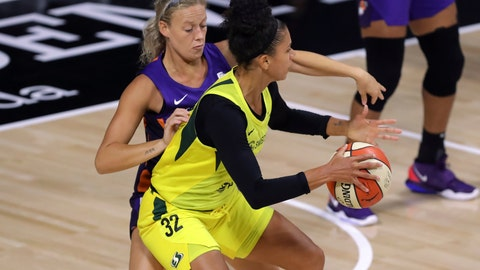 <p>               Seattle Storm's Alysha Clark (32) backs into the defense of Phoenix Mercury's Sophie Cunningham during the first half of a WNBA basketball game Saturday, Aug. 8, 2020, in Bradenton, Fla. (AP Photo/Mike Carlson)             </p>