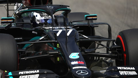 <p>               Mercedes driver Valtteri Bottas of Finland steers his car during a practice session prior to the Formula One Grand Prix at the Barcelona Catalunya racetrack in Montmelo, Spain, Friday, Aug. 14, 2020. (Bryn Lennon, Pool via AP)             </p>