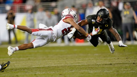 <p>               FILE - In this Dec. 6, 2018, file photo, Oregon safety Jevon Holland (8) breaks up a pass for Utah wide receiver Jaylen Dixon (25) during the first half of the Pac-12 Conference championship NCAA college football game in Santa Clara, Calif. A group of Pac-12 football players on Sunday, Aug. 2, 2020, threatened to opt out of the coming season unless its concerns about competing during the COVID-19 pandemic and other racial and economic issues in college sports are addressed. (AP Photo/Tony Avelar, File)             </p>
