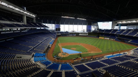 <p>               FILE - This is a July 4, 2020, file photo showing the Miami Marlins running drills during a baseball workout at Marlins Park in Miami. Marlins Park will have a new look for its 2020 season debut Friday, thanks to cozier dimensions and a switch to artificial turf. Also, the home team is in first place. (AP Photo/Wilfredo Lee, File)             </p>