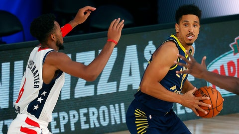 <p>               Indiana Pacers Malcolm Brogdon (7) handles the ball as Washington Wizards Troy Brown Jr. (6) defends during the first half of an NBA basketball game Monday, Aug. 3, 2020, in Lake Buena Vista, Fla. (Mike Ehrmann/Pool Photo via AP)             </p>