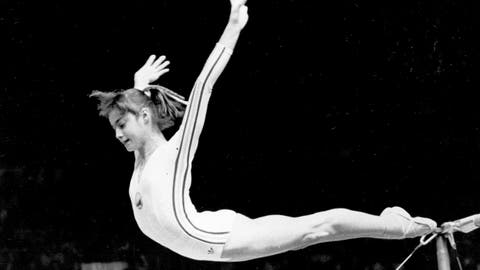 <p>               FILE - In this July 18, 1976, file photo, Romania's Nadia Comaneci dismounts from the uneven parallel bars to score a perfect 10.00 in the women's gymnastics competition at the Summer Olympic Games in Montreal. (AP Photo/Suzanne Vlamis, File)             </p>