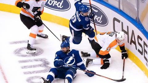 <p>               Tampa Bay Lightning left wing Alex Killorn, bottom, and center Tyler Johnson (9) work for the puck against Philadelphia Flyers center Sean Couturier (14) and defenseman Philippe Myers (5) during the second period of an NHL hockey playoff game Saturday, Aug. 8, 2020, in Toronto. (Frank Gunn/The Canadian Press via AP)             </p>