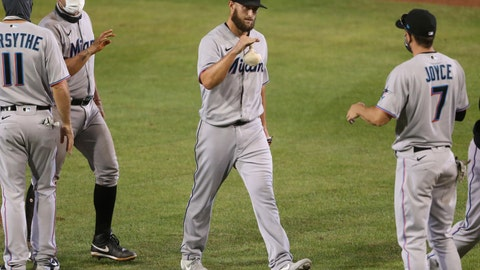 <p>               Miami Marlins pitcher Josh A. Smith celebrates his win with teammates following the tenth inning of a baseball game against the Toronto Blue Jays, Wednesday, Aug. 12, 2020, in Buffalo, N.Y. (AP Photo/Jeffrey T. Barnes)             </p>
