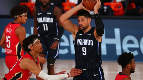 <p>               Orlando Magic center Nikola Vucevic (9) controls the ball against New Orleans Pelicans center Jaxson Hayes, front left, during the first half of an NBA basketball game Thursday, Aug. 13, 2020, in Lake Buena Vista, Fla. (Kim Klement/Pool Photo via AP)             </p>