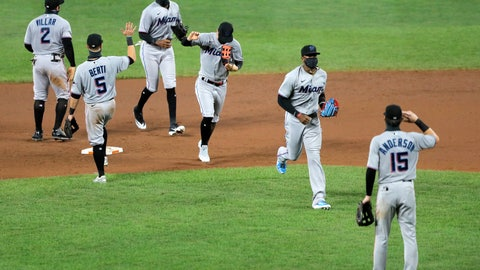 <p>               Miami Marlins players engage in a social distant celebration after defeating the Baltimore Orioles 4-0 during a baseball game, Tuesday, Aug. 4, 2020, in Baltimore. (AP Photo/Julio Cortez)             </p>
