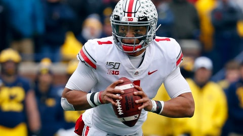 <p>               FILE - In this Nov. 30, 2019, file photo, Ohio State quarterback Justin Fields rolls out to throw against Michigan during the first half of an NCAA college football game in Ann Arbor, Mich. Ohio State opens preseason training camp on Thursday, Aug. 6, 2020, with strict coronavirus protocols in place and under a cloud of uncertainty about whether a revised 10-game season will even be played at all. (AP Photo/Paul Sancya, File)             </p>