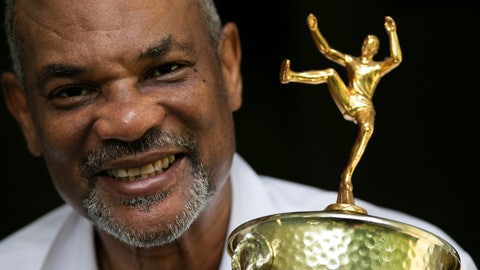 <p>               - Benn Fields holds a high jump trophy, Friday, July 31, 2020, in Salisbury Mills, N.Y. Fields will forever be known as a U.S. Olympian, he will also always wonder about what might have been had the U.S. government not spearheaded a boycott of the 1980 Olympic Games in Moscow. (AP Photo/Mark Lennihan)             </p>