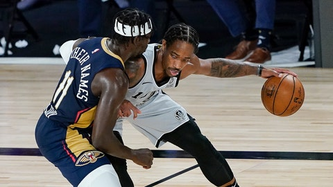 <p>               San Antonio Spurs forward DeMar DeRozan, right, tries to keep the ball away from New Orleans Pelicans guard Jrue Holiday (11) during the second half of an NBA basketball game, Sunday, Aug. 9, 2020, in Lake Buena Vista, Fla. (AP Photo/Ashley Landis, Pool)             </p>