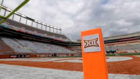 <p>               FILE - In this Oct. 7, 2017, file photo, a Big 12 pylon marks the end zone at Darrell K Royal Texas Memorial Stadium before an NCAA college football game between Texas and Kansas State in Austin, Texas. Big 12 schools have agreed to play one nonconference football game this year to go along with their nine league contests as plans for the pandemic-altered season continued to fall into place. (AP Photo/Eric Gay, File)             </p>