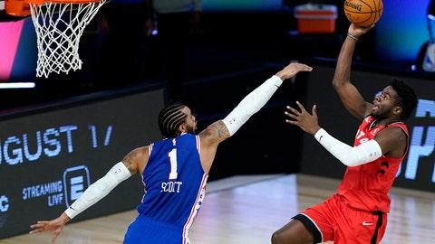 <p>               Toronto Raptors' Terence Davis, right, shoots against Philadelphia 76ers' Mike Scott during the second half of an NBA basketball game Wednesday, Aug. 12, 2020 in Lake Buena Vista, Fla. (AP Photo/Ashley Landis, Pool)             </p>