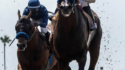 <p>               In this image provided by Benoit Photo, Thousand Words, right, with Abel Cedillo aboard, outlegs Cezanne, left, with Flavien Prat aboard, to win the $100,000 Shared Belief Stakes horse race Saturday, Aug. 1, 2020, at Del Mar Thoroughbred Club in Del Mar, Calif. (Benoit Photo via AP)             </p>