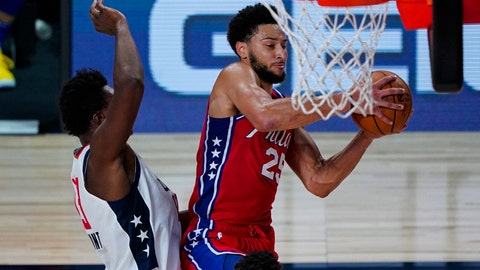 <p>               Philadelphia 76ers guard Ben Simmons (25) grabs a rebound in front of Washington Wizards center Thomas Bryant (13) during the second half of an NBA basketball game Wednesday, Aug. 5, 2020 in Lake Buena Vista, Fla. (AP Photo/Ashley Landis)             </p>
