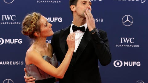 <p>               FILE - In this Monday, Feb. 18, 2019 file photo Serbian tennis player Novak Djokovic and his wife Jelena arrive for the 2019 Laureus World Sports Awards. Novak Djokovic has tested positive for the coronavirus after taking part in a tennis exhibition series he organized in Serbia and Croatia. The top-ranked Serb is the fourth player to test positive for the virus after first playing in Belgrade and then again last weekend in Zadar, Croatia. His wife also tested positive. (AP Photo/Claude Paris, File)             </p>