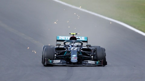 <p>               Mercedes driver Valtteri Bottas of Finland steers his car with a flat tire during the British Formula One Grand Prix at the Silverstone racetrack, Silverstone, England, Sunday, Aug. 2, 2020. (Andrew Boyers/Poolvia AP)             </p>