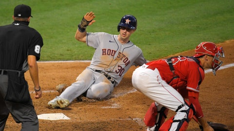 <p>               Houston Astros' Kyle Tucker, center, scores on a sacrifice fly by George Springer as Los Angeles Angels catcher Jason Castro, right, takes a late throw and home plate umpire Cory Blaser watches during the fourth inning of a baseball game Friday, July 31, 2020, in Anaheim, Calif. (AP Photo/Mark J. Terrill)             </p>