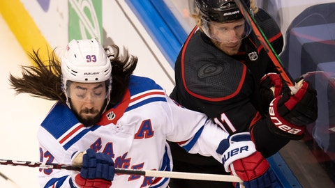 <p>               New York Rangers center Mika Zibanejad (93) checks Carolina Hurricanes center Jordan Staal (11) into the boards during the first period of an NHL Stanley Cup playoff hockey game in Toronto, Monday, Aug. 3, 2020. (Frank Gunn/The Canadian Press via AP)             </p>