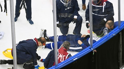 <p>               Medical staff surround Toronto Maple Leafs defenseman Jake Muzzin as he lays on the ice waiting to be placed on a stretcher as they play against the Columbus Blue Jackets during the third period of an NHL hockey playoff game  Tuesday, Aug. 4, 2020 in Toronto. (Nathan Denette/The Canadian Press via AP)             </p>