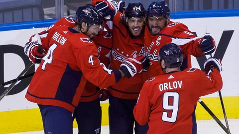 <p>               Washington Capitals left wing Alex Ovechkin (8), right wing T.J. Oshie (77), center Nicklas Backstrom (19), defenseman Brenden Dillon (4) and defenseman Dmitry Orlov (9) celebrate Oshie's goal against the Boston Bruins during first-period NHL hockey Stanley Cup qualifying round game action in Toronto, Sunday, Aug. 9, 2020. (Cole Burston/The Canadian Press via AP)             </p>