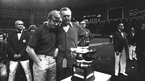 <p>               FILE - In this Dec. 23, 1974, file photo, North Carolina State coach Lou Holtz, left, and Houston coach Bill Yeoman look over the Astro-Bluebonnet Bowl trophy in Houston. The football teams played to a 31-31 tie, but Yeoman awarded the trophy to North Carolina State after the game. Yeoman, the longtime Houston football coach who led the Cougars to four Southwest Conference titles and a school-record 160 victories, has died. He was 92. The university announced the death Wednesday, Aug. 12, 2020, without providing details. Son, Bill Jr., told ESPN his father died of pneumonia and kidney failure. (AP Photo, File)             </p>