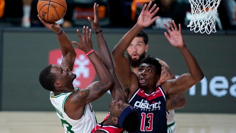 <p>               Boston Celtics' Javonte Green, left, heads to the basket past Washington Wizards' Isaac Bonga and Thomas Bryant (13) during the second half of an NBA basketball game Thursday, Aug. 13, 2020 in Lake Buena Vista, Fla. (AP Photo/Ashley Landis, Pool)             </p>