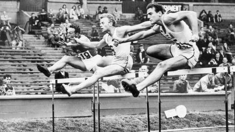 <p>               FILE - In this Aug. 7. 1948 file photo, Bob Mathias, right, is shown during the Olympic decathlon in London. At left is Oto Rebula of Yugoslavia and at center is Orn Clausen of Iceland. The Associated Press was in London when it staged the first Olympics after World War II. Bob Mathias took up decathlon at the suggestion of his high school coach in Tulare, California. Less than three months later he qualified for the 1948 Games and soon found himself standing in Wembley Stadium. Mathias won the decathlon and, at 17, became the youngest male winner of a track and field event in Olympic history.  (AP Photo, File)             </p>