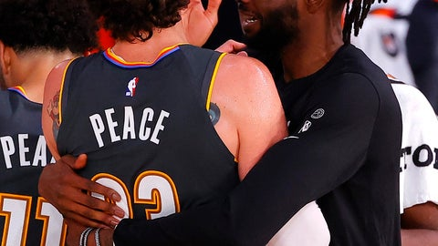 <p>               Nerlens Noel hugs Mike Muscala, left, of the Oklahoma City Thunder after Muscala hit the game-winning three-point basket against the Miami Heat during the second half of an NBA basketball game Wednesday, Aug. 12, 2020, in Lake Buena Vista, Fla. (Kevin C. Cox/Pool Photo via AP)             </p>