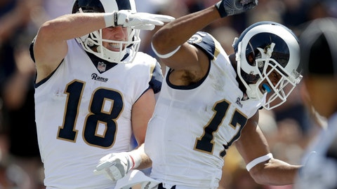 <p>               FILE - In this Sept. 10, 2017, file photo, Los Angeles Rams wide receiver Cooper Kupp, left, celebrates his touchdown with wide receiver Robert Woods during the first half of an NFL football game against the Indianapolis Colts in Los Angeles. Kupp and Woods spent the offseason getting kicked off various high school football fields while trying to get in some COVID-clandestine workouts. (AP Photo/Jae C. Hong, File)             </p>