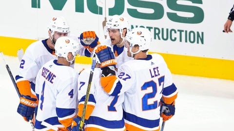 <p>               New York Islanders center Mathew Barzal (13) celebrates his goal with teammates as Florida Panthers players look on from the bench during the third period NHL Stanley Cup Playoff qualifying round hockey game in Toronto, Friday, Aug. 7, 2020. (Chris Young/The Canadian Press via AP)             </p>
