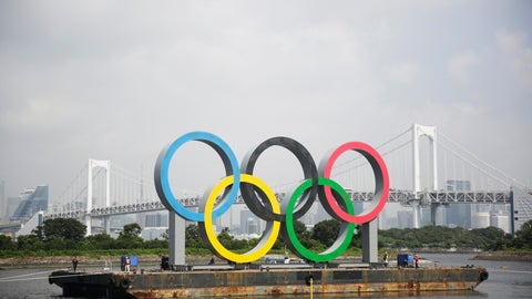 """<p>               A symbol installed for the Olympic and Paralympic Games Tokyo 2020 on a barge is moved away from its usual spot by tugboats off the Odaiba Marine Park in Tokyo Thursday, Aug. 6, 2020. The five Olympic rings floating on a barge in Tokyo Bay were removed for what is being called """"maintenance,"""" and officials says they will return to greet next year's Games. The Tokyo Olympics have been postponed for a year because of the coronavirus pandemic and are to open on July 23, 2021. The Paralympics follow on Aug. 24. (AP Photo/Hiro Komae)             </p>"""