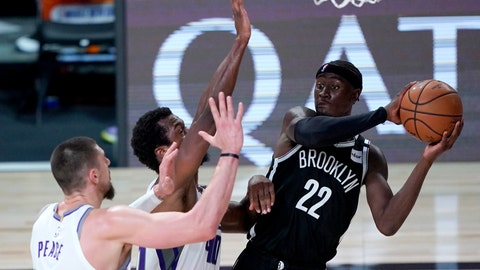 <p>               Brooklyn Nets' Caris LeVert (22) looks to pass the ball as Sacramento Kings' Alex Len, left, and Harrison Barnes defend during the second half of an NBA basketball game Friday, Aug. 7, 2020 in Lake Buena Vista, Fla. (AP Photo/Ashley Landis, Pool)             </p>