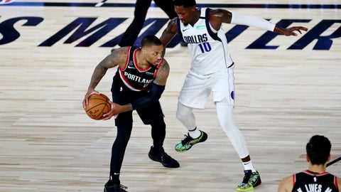 <p>               Portland Trail Blazers guard Damian Lillard holds the ball while defended by Dallas Mavericks forward Dorian Finney-Smith (10) during the second half of an NBA basketball game Tuesday, Aug. 11, 2020, in Lake Buena Vista, Fla. (Kim Klement/Pool Photo via AP)             </p>