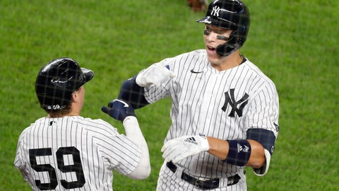 <p>               New York Yankees Aaron Judge, right, celebrates with the Yankees Luke Voit (59) after hitting a solo home run during the fifth inning of a baseball game against the Atlanta Braves, Tuesday, Aug. 11, 2020, in New York. (AP Photo/Kathy Willens)             </p>