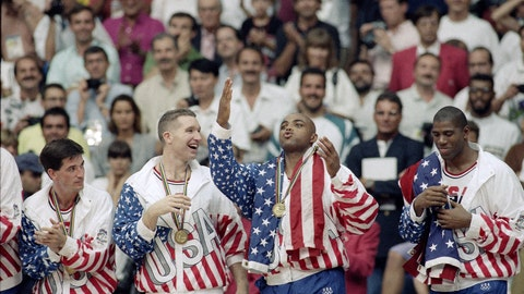 <p>               FILE - This Aug. 8, 1992, file photo shows, from left, USA's John Stockton, Chris Mullin, Charles Barkley and Magic Johnson rejoicing with their gold medals after beating Croatia 117-85 at the Summer Olympic Games in Barcelona. (AP Photo/John Gaps III, File)             </p>