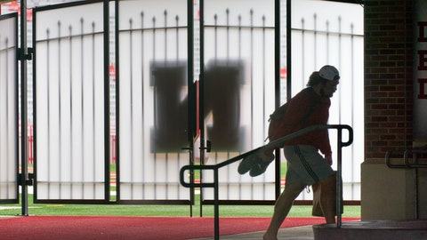 <p>               A player carries his shoes and a lunch bag in front of a closed gate leading to Memorial Stadium's playing field in Lincoln, Neb., Wednesday, Aug. 12, 2020. The Big Ten won't play football this fall because of concerns about COVID-19, becoming the first of college sports' power conferences to yield to the pandemic. The move announced Tuesday. (AP Photo/Nati Harnik)             </p>