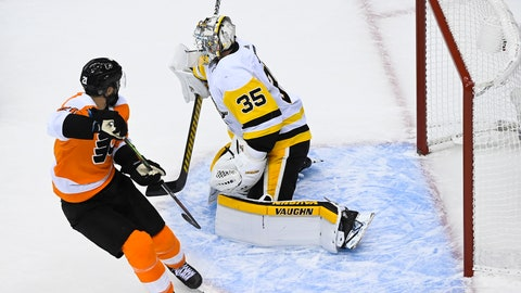 <p>               Philadelphia Flyers center Scott Laughton (21) scores the game winning goal against Pittsburgh Penguins goaltender Tristan Jarry (35) during overtime in an exhibition NHL hockey game, Tuesday, July 28, 2020 in Toronto. (Nathan Denette/The Canadian Press via AP)             </p>