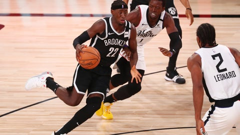 <p>               Brooklyn Nets guard Caris LeVert (22) dribbles the ball against Los Angeles Clippers guard Reggie Jackson (1) in the first half of an NBA basketball game Sunday, Aug. 9, 2020, in Lake Buena Vista, Fla. (Kim Klement/Pool Photo via AP)             </p>