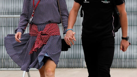 <p>               Mercedes driver Valtteri Bottas of Finland, right, and his girlfriend Tiffany Cromwell arrive at the paddocks for preparations before the 70th Anniversary Formula One Grand Prix at the Silverstone circuit, Silverstone, England, Thursday, Aug. 6, 2020.(AP Photo/Frank Augstein)             </p>